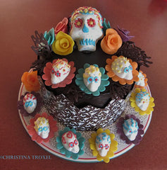 muertos cake with sugar skulls