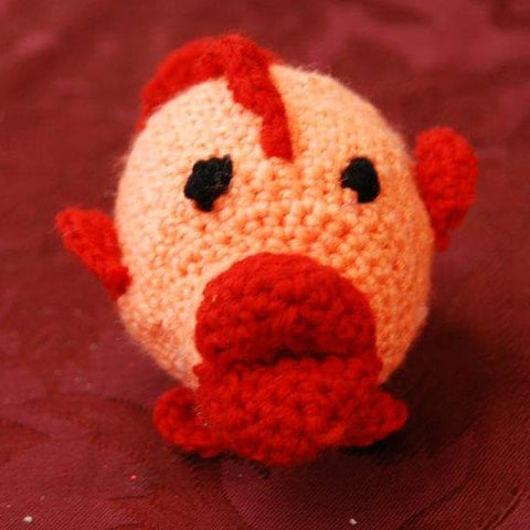 crocheted Amigurumi fish orange and red burgundy background straight hooked StraightHooked crochet
