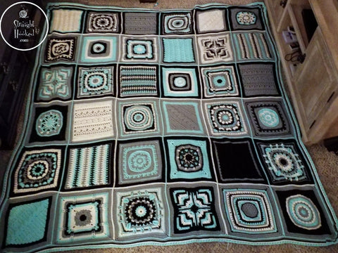 Patchwork Mystery CAL Finished Blanket on floor Straight Hooked