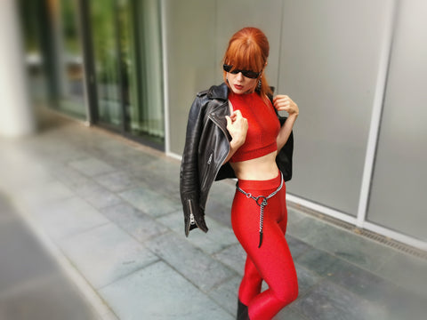 red leggings with chain belt