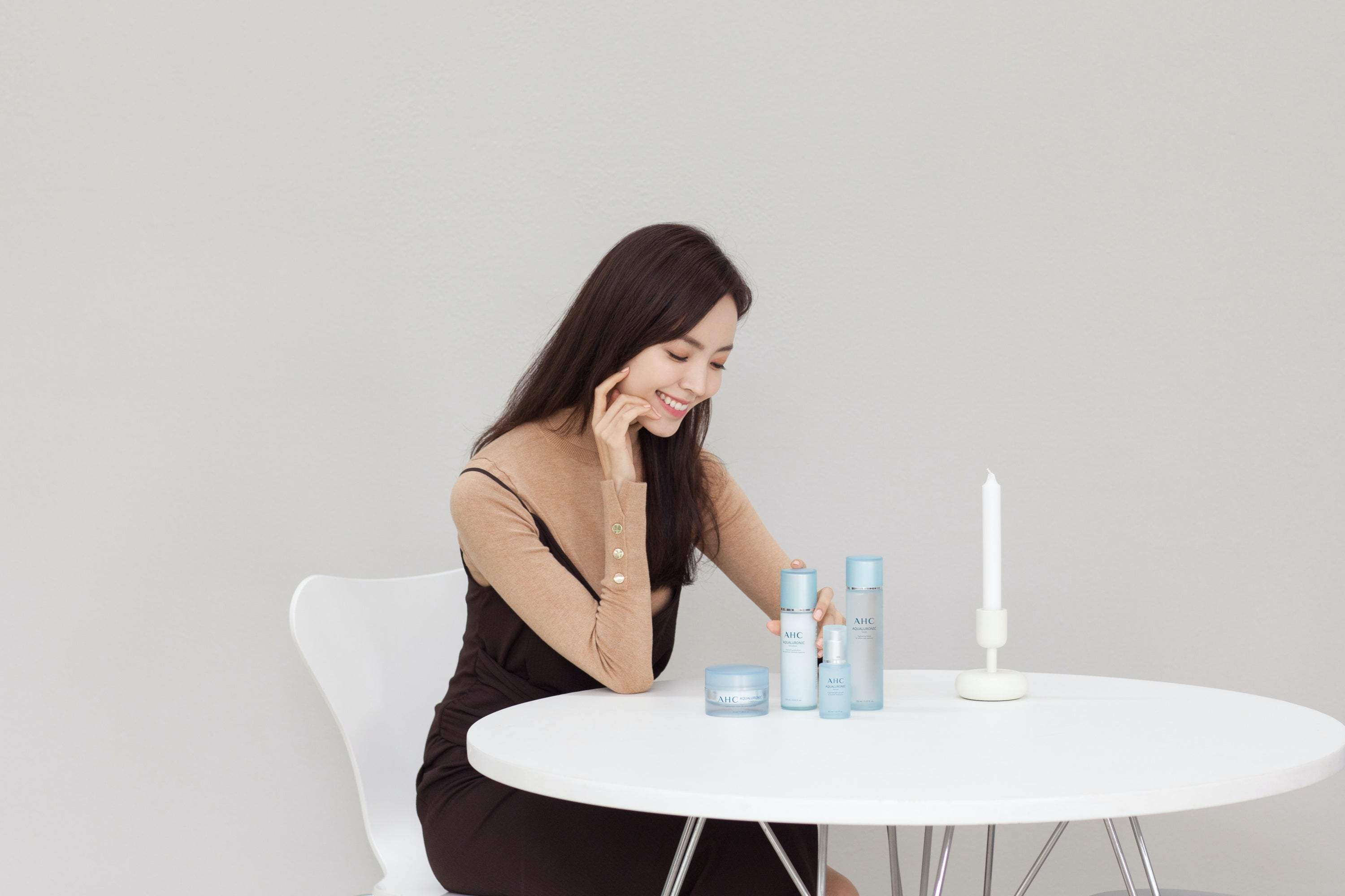 Asian woman sitting in table with AHC Aqualuronic series