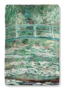 Image on small porcelain tray of Monet's Bridge and Water lilies. Green and lush.