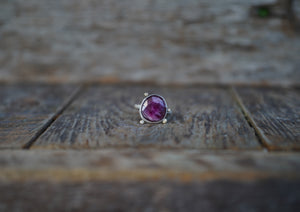 The Orb Ring in Ruby. 8.75. Reclaimed sterling silver + 14kt gold + Faceted Ruby