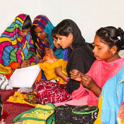 Women artisans working embroidering pieces