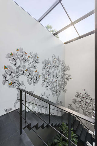 Hand drawn Gond painting on stairs inside a home