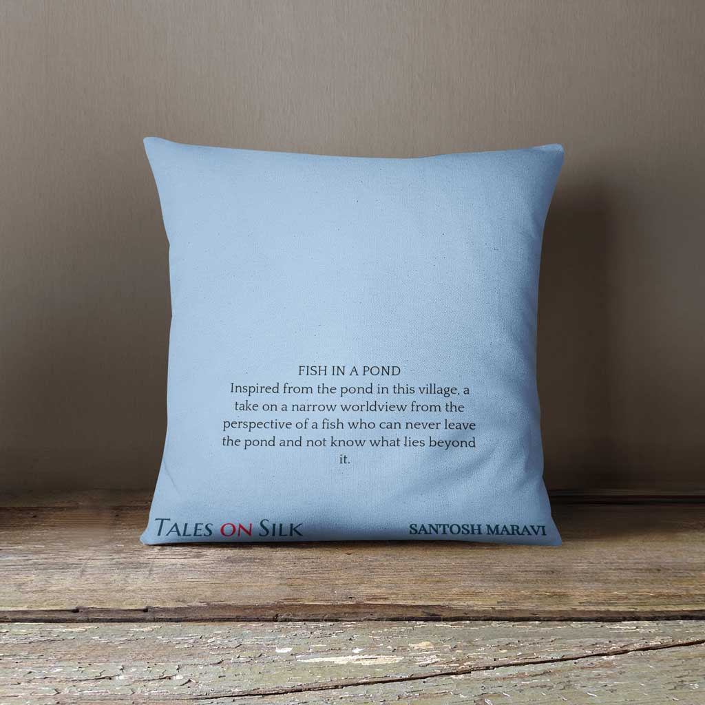 Blue cushion with black text with art description on the back