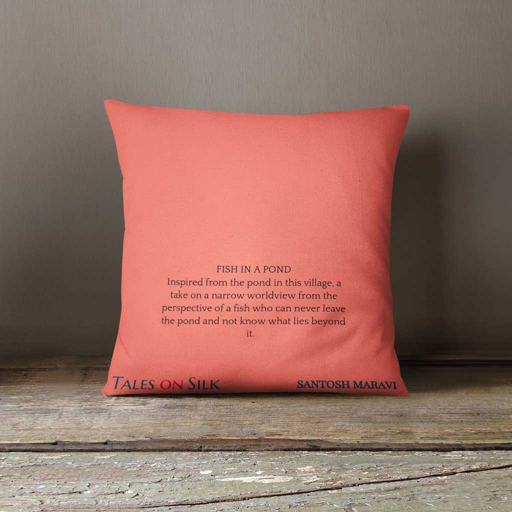 Coral cushion with black text with art description on the back