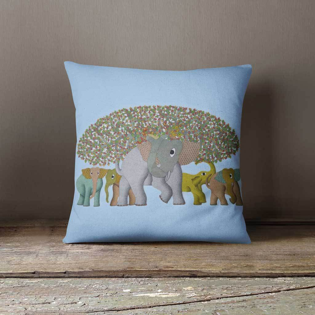 Blue cushion cover with an image of herd of elephants and tree