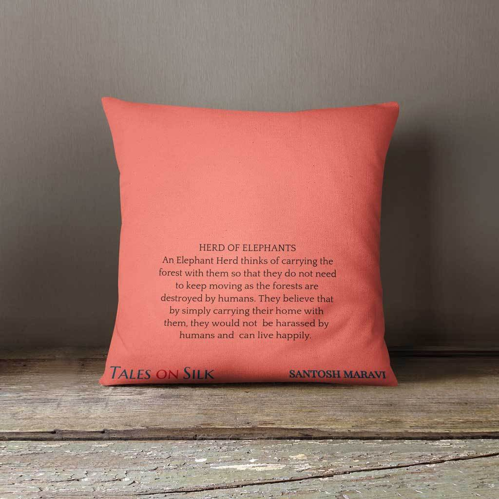 Coral cushion cover with a message from the artist in black on the back