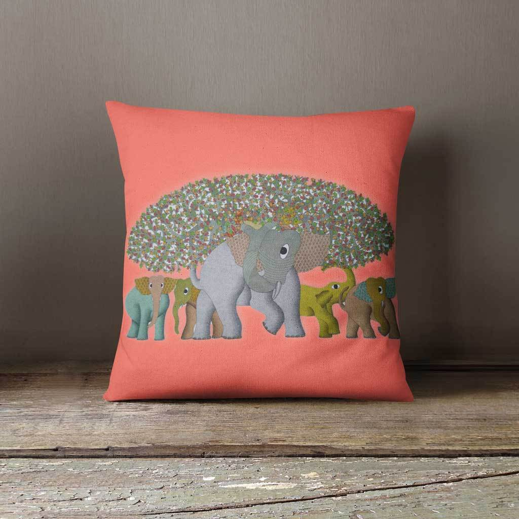 Coral cushion cover with an image of herd of elephants and tree