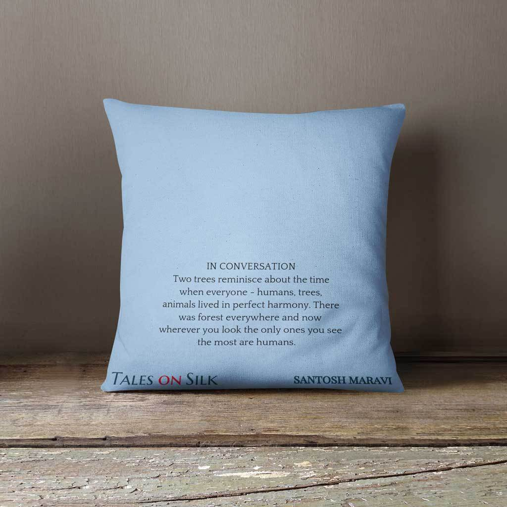 Blue cushion with black text on the back