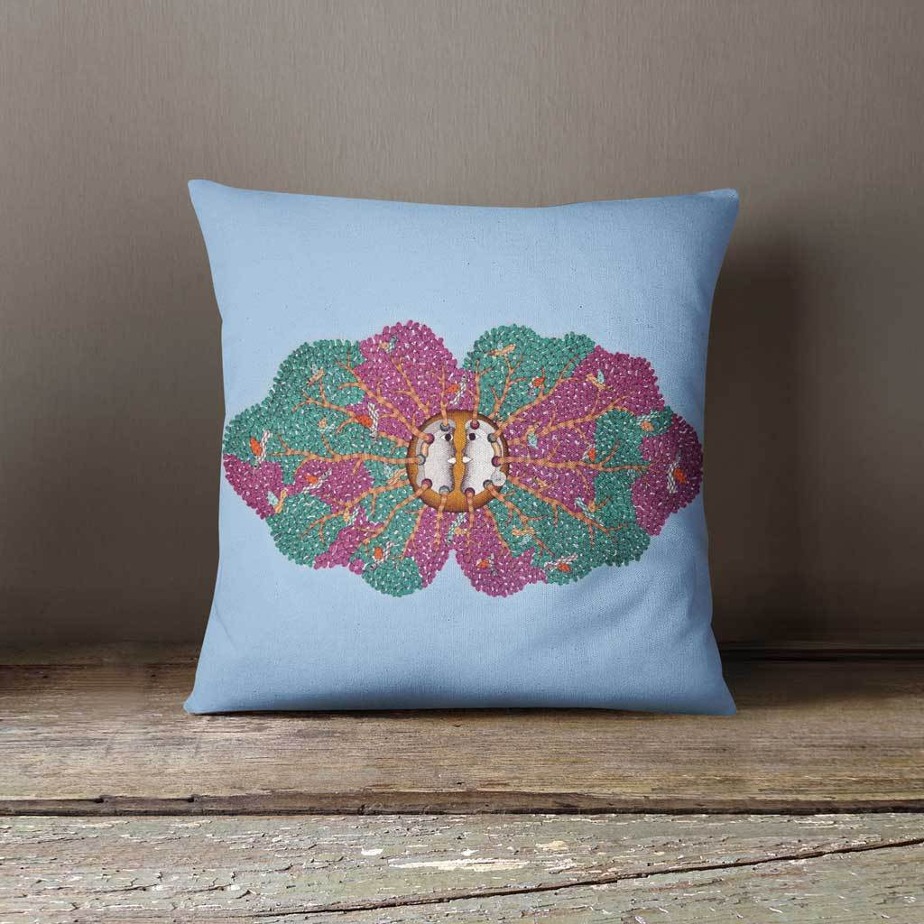 Blue cushion with purple and green tree motif