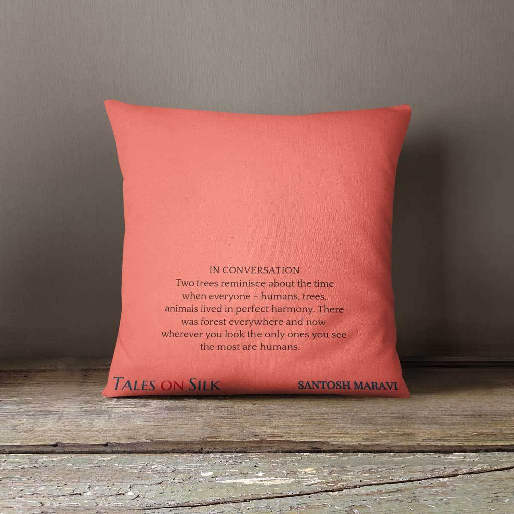 Coral cushion with text on the back