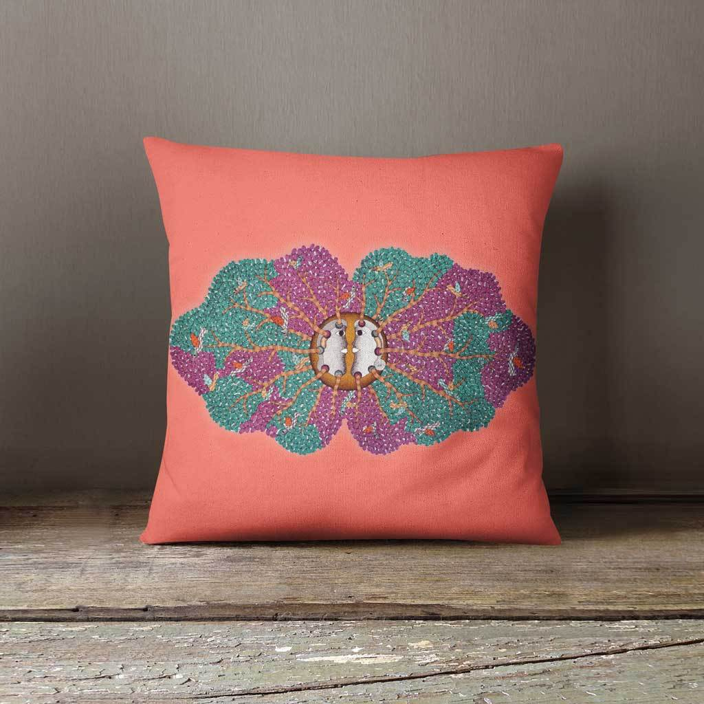 Coral cushion with purple and green tree motif