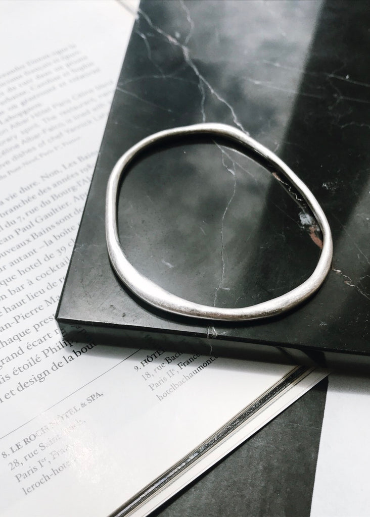 Warped design bangle