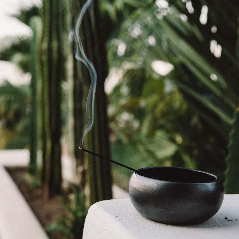PF Candle Co classic line incense stick burning over a black bowl