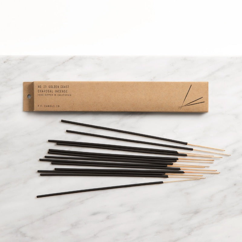PF Candle Co Classic Line Golden Coast incense sticks on a marble counter with the kraft packaging box