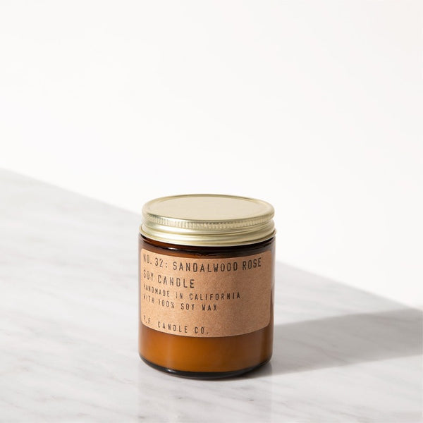 PF Candle Co Classic Line Sandalwood Rose mini candle in an amber glass jar with kraft label and brass lid