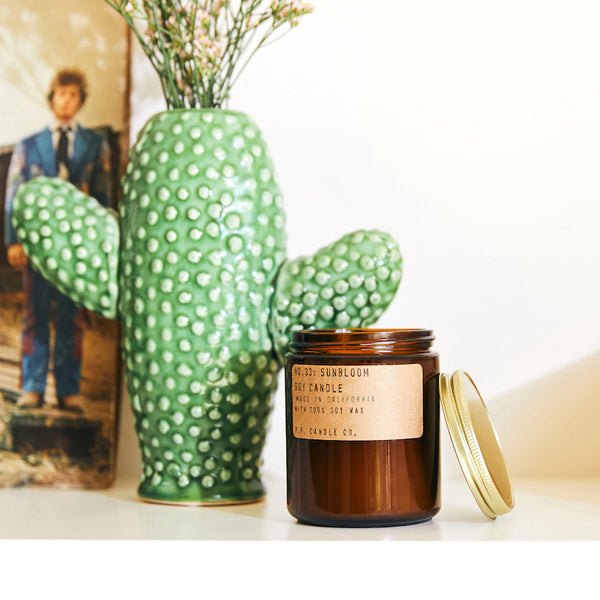 PF Candle Co Culver City Sunbloom scented soy wax candle inspired by day-tripping in the desert, spring's first bloom, infinite blankets of kaleidoscopic wildflowers., with scent notes of golden-rayed lily, yarrow, and tonka bean