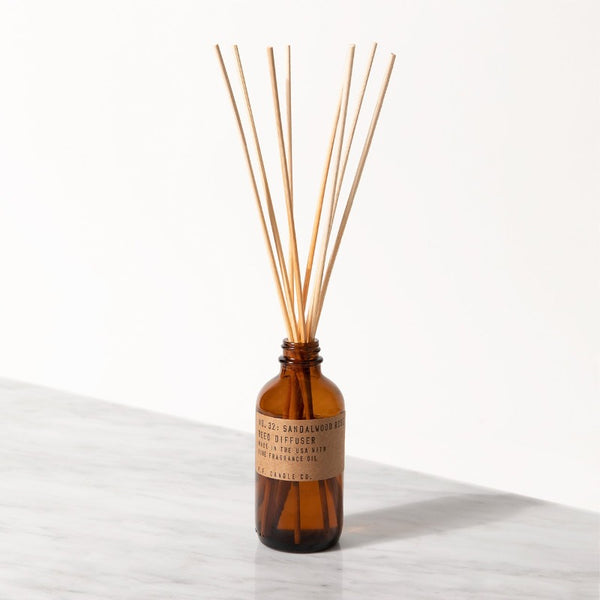 PF Candle Co Sandalwood Rose classic line reed diffuser in a glass bottle with kraft label with rattan reed sticks inside