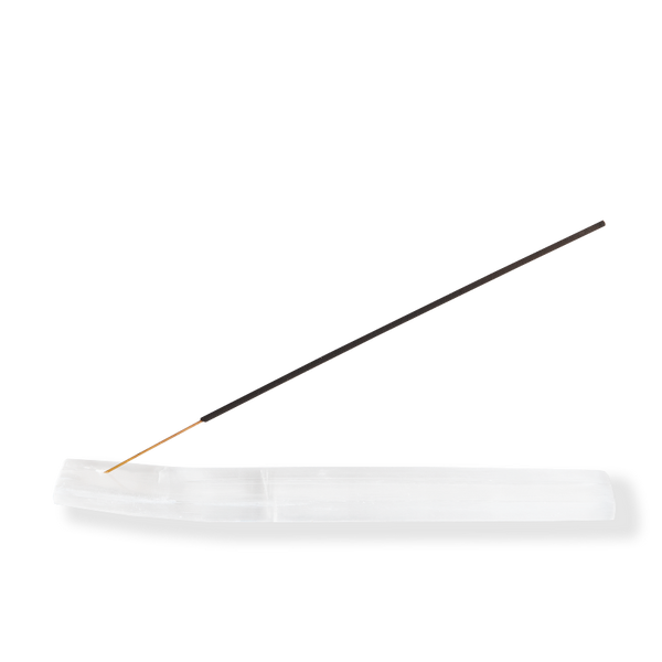 Long rectangular white selenite incense holder holding charcoal incense stick against white background.