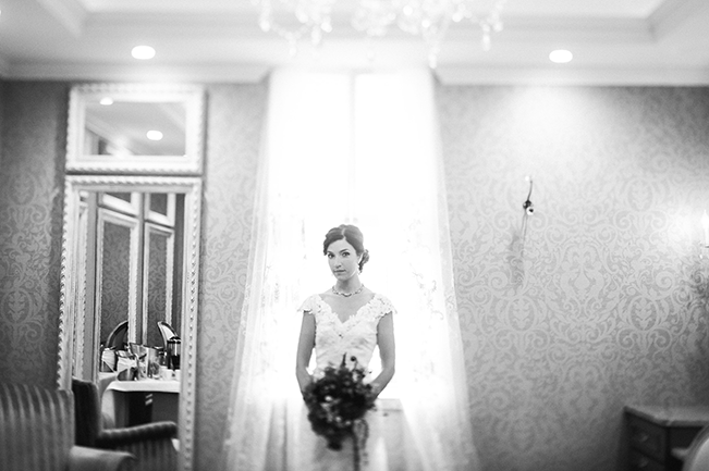 Bride-and-Flowers-in-Front-of-Window