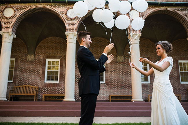 bride-and-groom-releasing-balloons