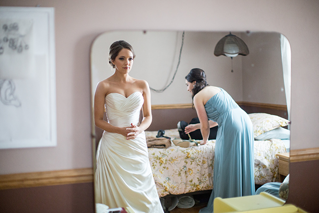 bride-looking-in-mirror-at-gown
