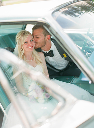 bride-and-groom-in-classic-car