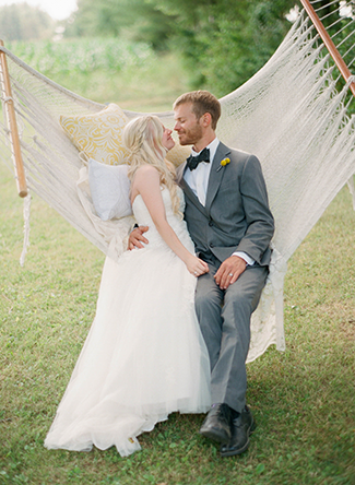 bride-and-groom-kissing-on-a-hammock