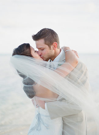 Bride-and-Groom-Kissing-on-Beach