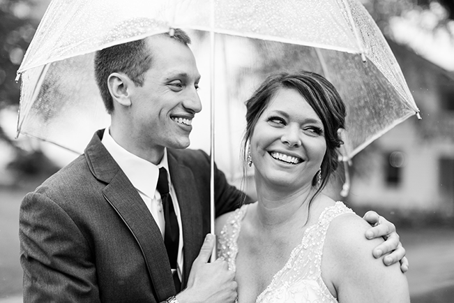 Bride-and-Groom-Under-Umbrellas