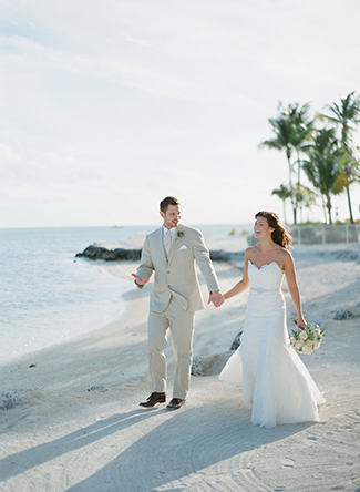 Bride-and-Groom-Walking-on-Beach