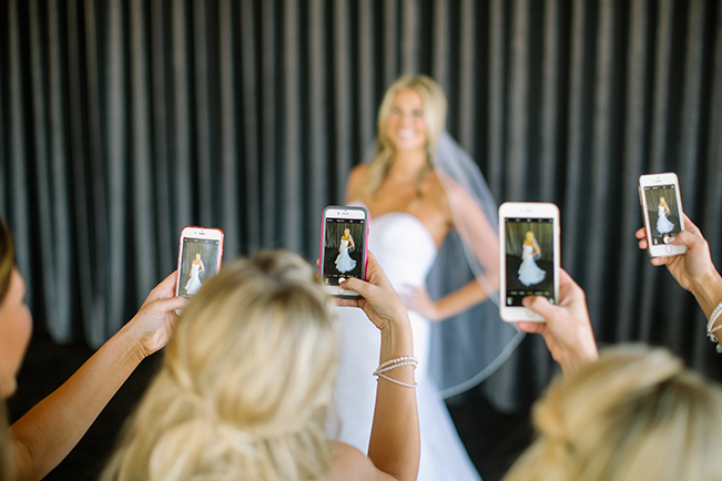 bridesmaids-taking-picture-of-bride