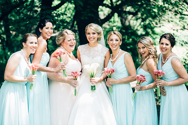 bridesmaids in mint and maid of honor in pink