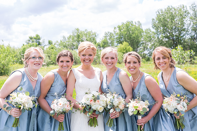 bridal party in pale blue bridesmaid dresses