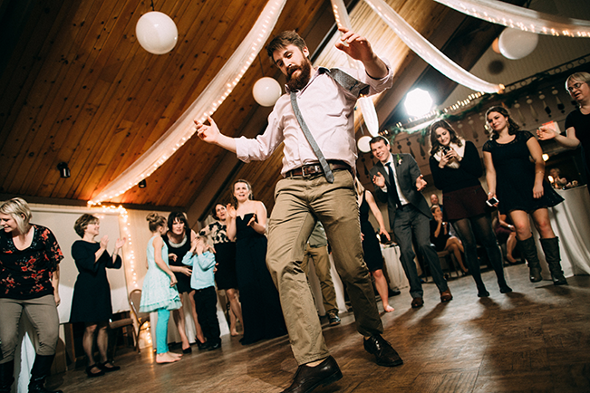 groomsman dancing at wedding reception