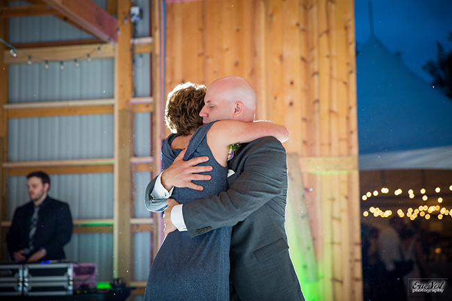 groom hugging his mom during mother son dance