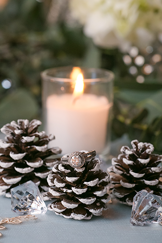 candle and pine cone wedding centerpieces