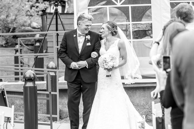 bride with her father before walking down the aisle