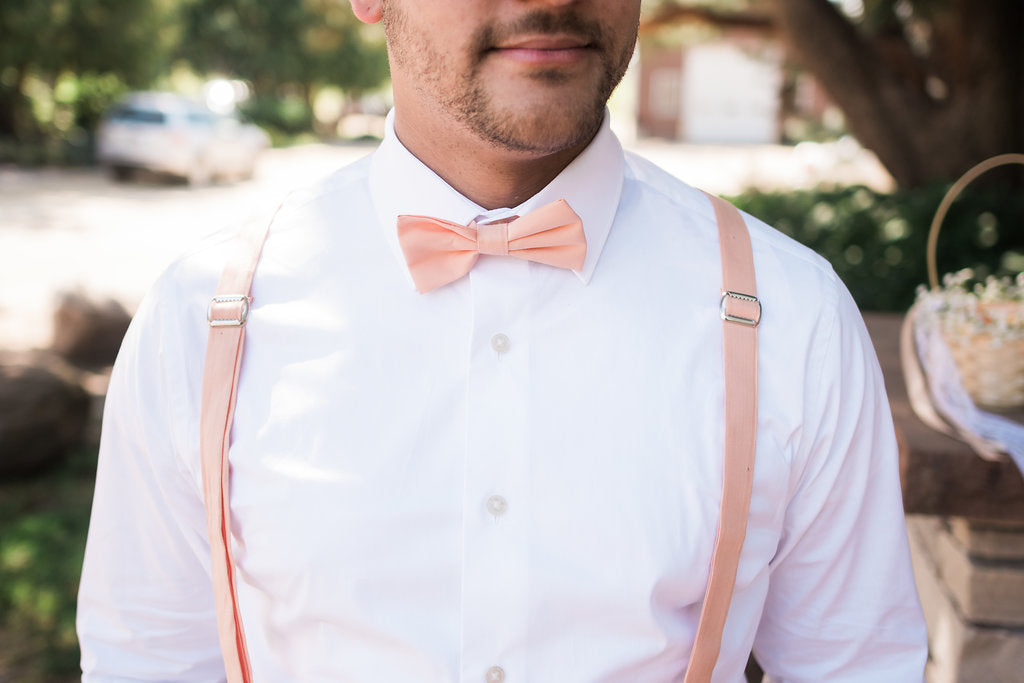 peach bow tie and suspenders