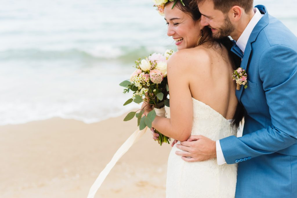 couple holding each other on the beach | Top Mistakes to Avoid With Your Minnesota Wedding Photographer