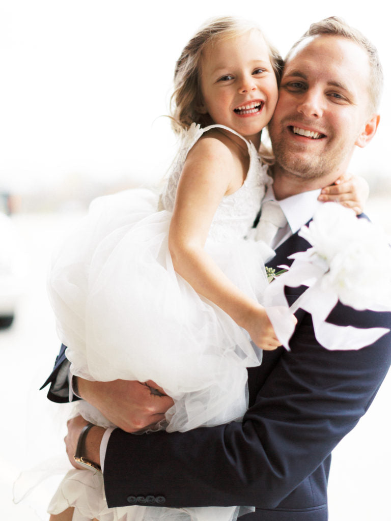 groom with flower girl | Should I Have Kids at My Wedding?