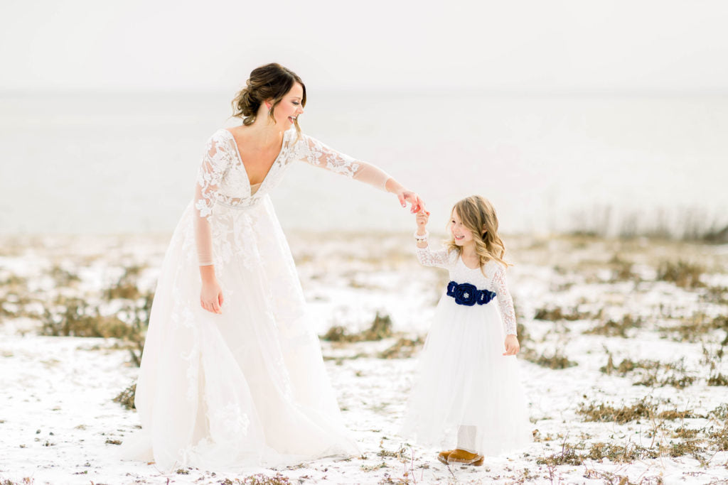 bride with flower girl | Should I Have Kids at My Wedding?