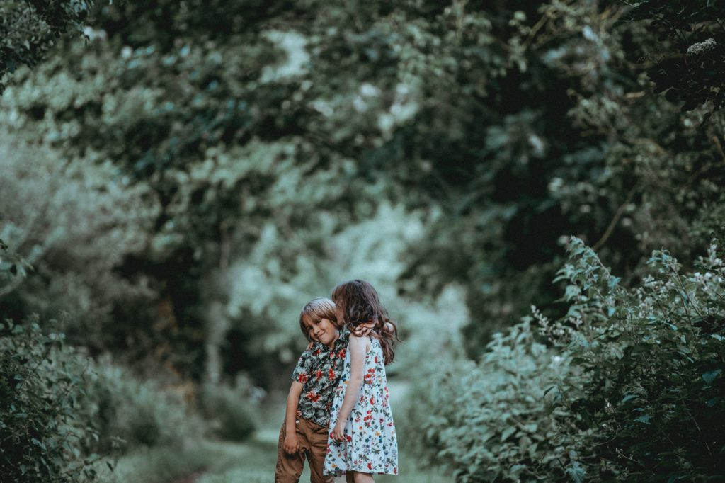 two kids together in forest | Should I Have Kids at My Wedding?