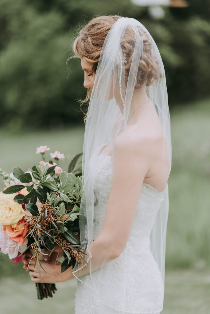 Bride holding bouquet | How to Own Your Bridezilla Side