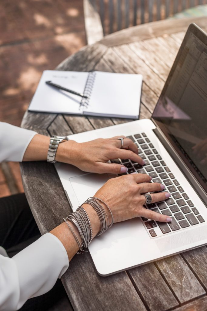 person typing on laptop | How to Own Your Bridezilla Side