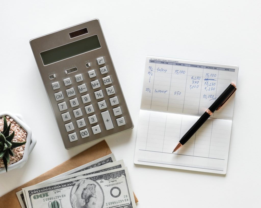 budget planner with calculator and money  | Should I Hire a Day-of Wedding Coordinator?