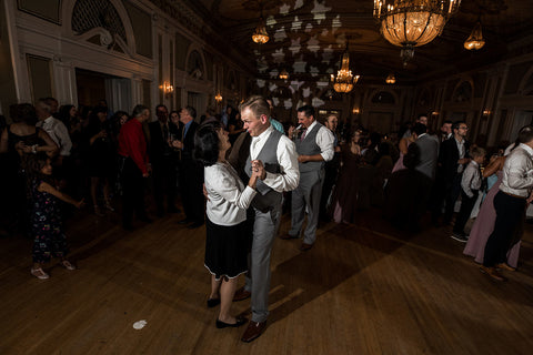 Groom dancing with a relative during the Dollar Dance
