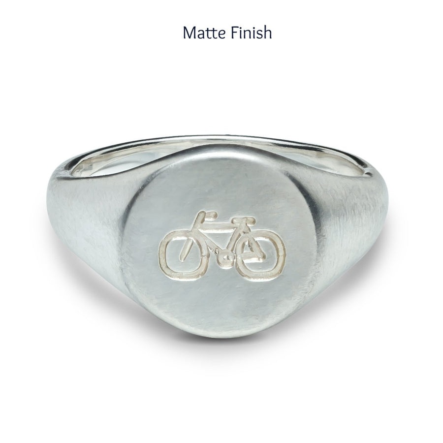 matte finish mans silver signet ring engraved with bike symbol from off the map jewellery